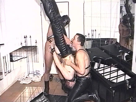 Upside down slave is flogged and clamped